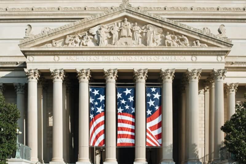 us a flag on white concrete column