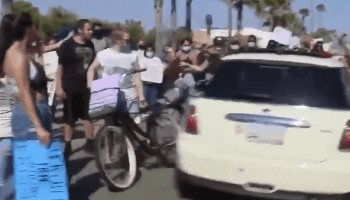 A Car Plows Though Protesters in Newport Beach
